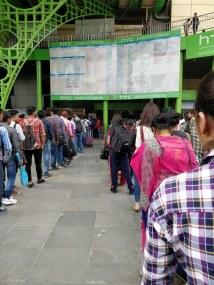 Passenger lines snaking across corners (Holi rush)